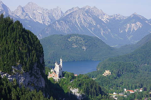 Neuschwanstein and Hohenschwangau castle with lake Alpsee in the Background