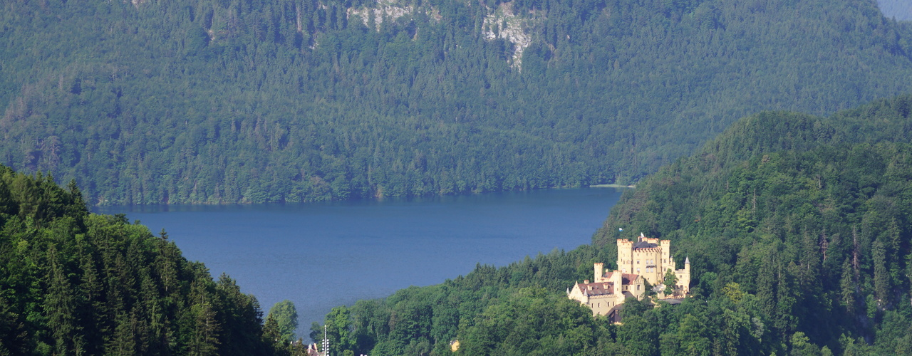 Hohenschwangau castle with lake Alpsee in the background